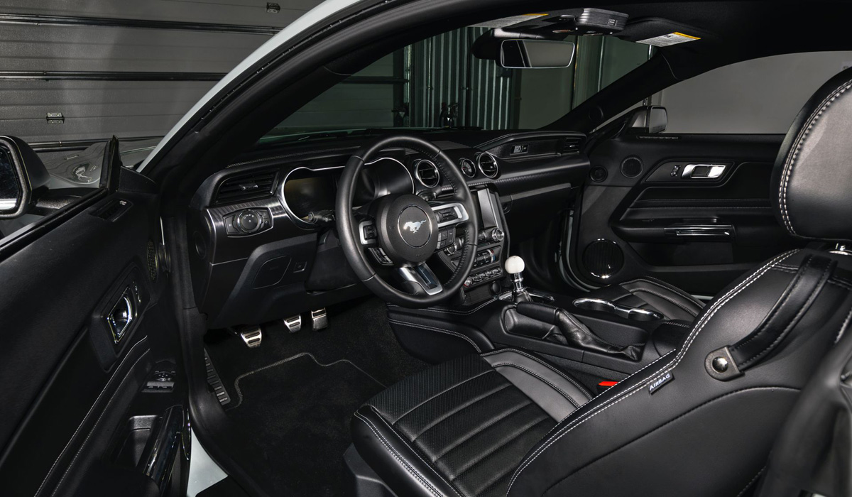There are not many changes in the interior: Mach 1 is equipped with a virtual instrument cluster, an upgraded media system with a 12.3-inch display, new door panels,