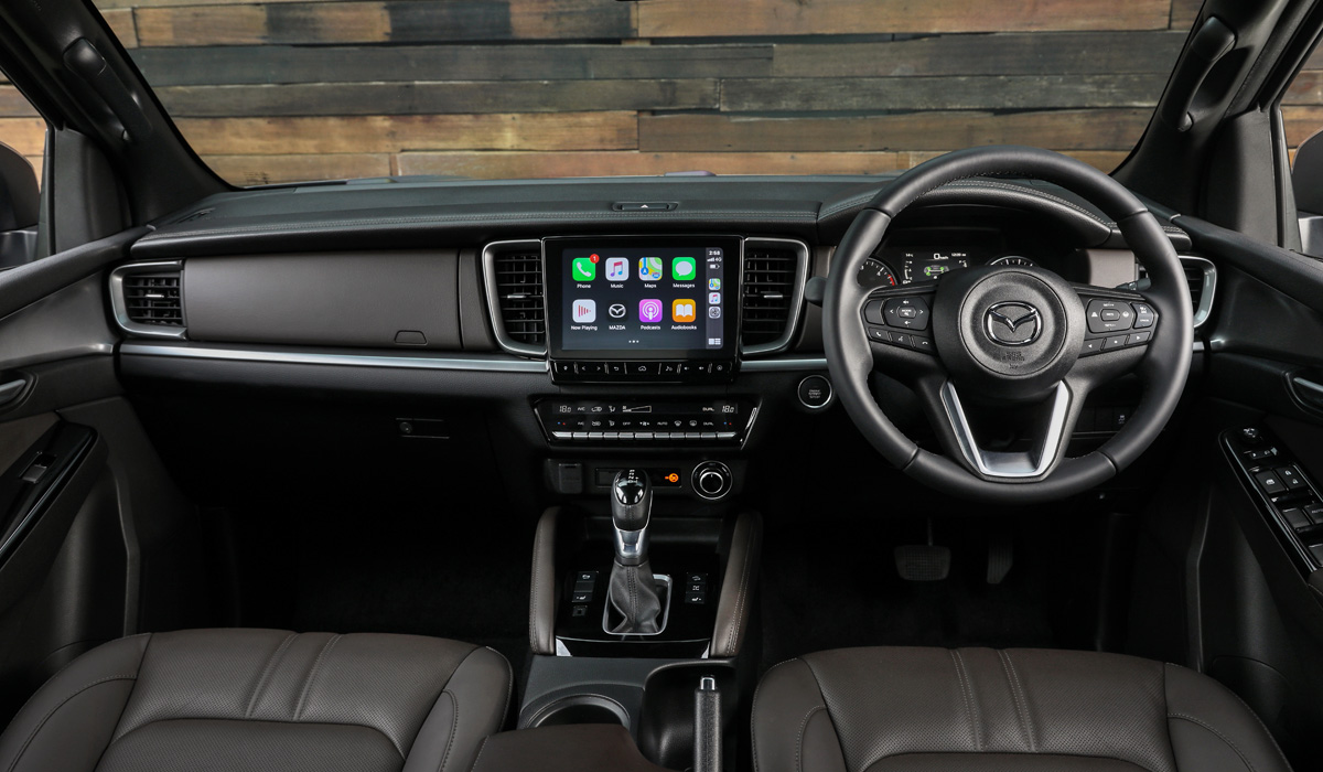 Mazda's stylists also did a good job on the interior. The location of key elements such as ventilation deflectors, media system screen, or climate control unit is the same as that of Isuzu, but the design is still different