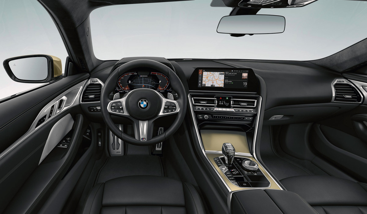 The interior is decorated with a large gold insert on the Central tunnel, inscriptions with the name of the special version on the headrests, as well as finishing the volume control, engine start button, iDrive washer